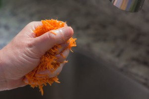gently squeezing carrot
