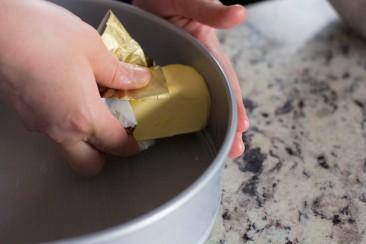 Butter a cake pan